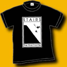 A 100% black shirt with the image of a person and his wheelchair falling off the side of a harrowing set of stairs. It says: STAIRS, the final frontier.Original Dan Wilkin's design.  2 child medium left.